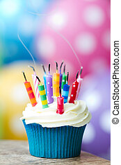 Partys over - Cupcake with extinguished birthday candles