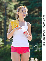 Sporty young female with bottle of water