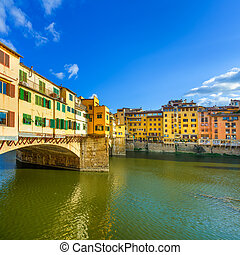 Ponte Vecchio landmark on sunset, old bridge, Arno river in...