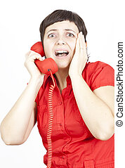 Scared woman at the phone - Businesswoman screaming into a...