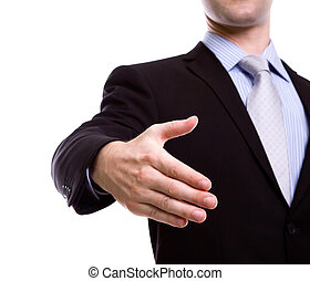 Portrait of young business man extending hand to shake against white background