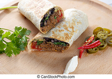 Burrito - Beef Burrito on wooden board with red chillies...