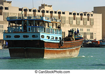 Dhow merchant ship on the Creek of Dubai - An empty...