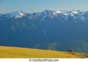 Couple on the hiking trail - Couple on a hiiking trail in...