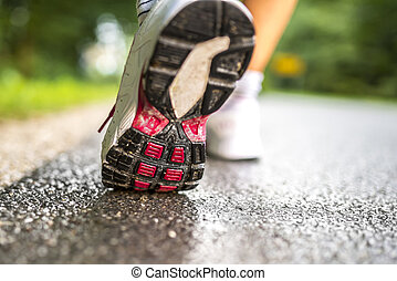 Closeup of runner feet running