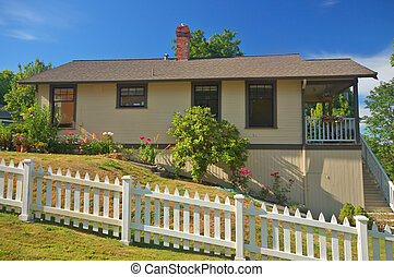 Residential house - Quaint Wooden house with a white picket...