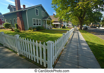 Residential neighborhood - Quaint Wooden house with a white...