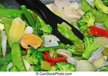 stir fry - cooking stir fry vegatables in the frying pan