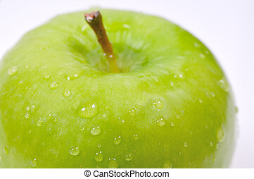 green apple - closeup shot of a watery wet green apple