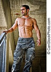 Hot, muscular construction worker shirtless seen from below