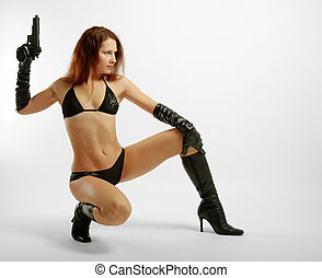 Seminude girl squatting with gun - Squatty woman in black...