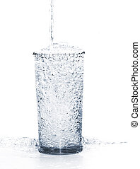 pouring water into the glass isolated on a white background