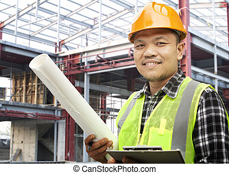 Portrait of construction worker at construction site - Male...