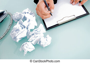 fingers of man with pen writing pad with white background