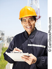 Industrial engineer - Portrait of asian engineer smiling...