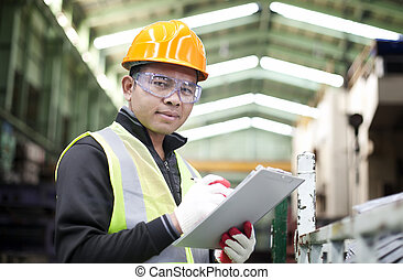 Industrial engineer - Portrait asian engineer with checklist...