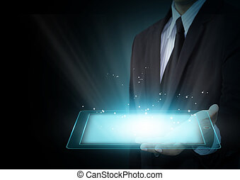 Tablet touch computer gadget - Male hands holding a tablet...