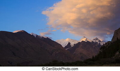 The sun is setting, there are stars. Tien Shan. Time Lapse -...