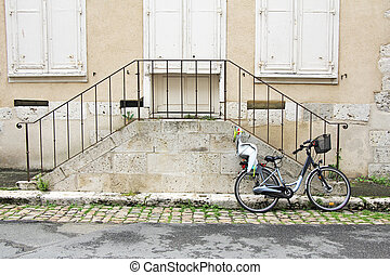 bike and stairs - bicycle with child seat, leaning against...