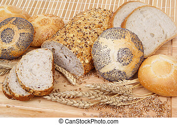 breads - variable types of bread and rolls as background