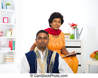 indian mother and son in the living room