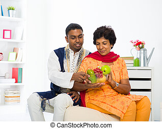 healthy indian mother and son dining