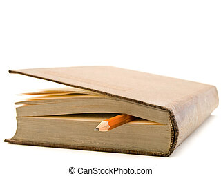 book and pencil - pencil and used brown book over the white...