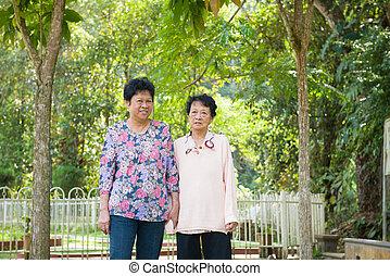 Asian senior females walking in the park