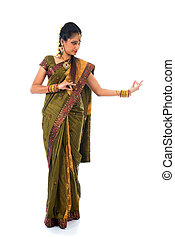 indian female dancer dancing in white background