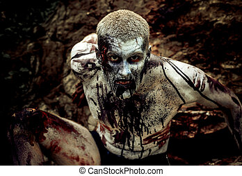 zombie - young man with a zombie body painting, covered with...