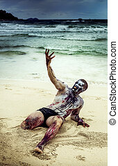 zombie on the beach - young man with a zombie body...