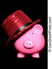 piggy bank wearing red hat on a black background