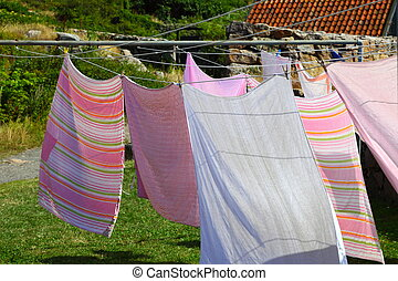 clothes hanging to dry on a laundry line outdoor
