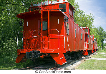 Caboose - Old red caboose on tracks