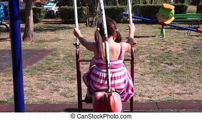 Unidentified girl on a swing