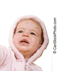 Baby in Pink Reaching Up - A cute baby in a pink jacket and...