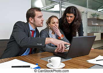 Office Meeting - Three staff members discussing financial...