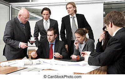 Discussing Plans - A company manager, and his team,...