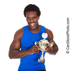 Happy African Athlete Holding Trophy