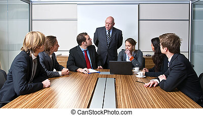 Management Meeting - A company manager, and his team,...