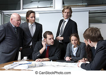 Office Meeting - A company director discussing plans with...