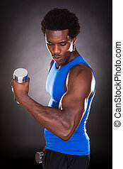 Young Man Holding Dumbbell