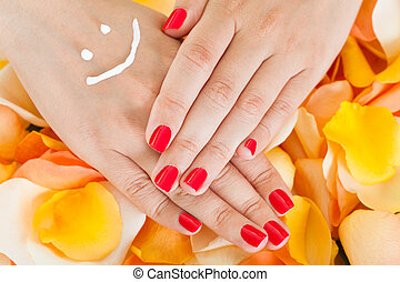 Woman's Hand Above Flower Petals - Close-up Of Woman's Hand...