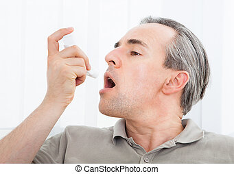 Man with asthma inhaler
