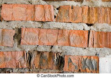 broken red brick wall