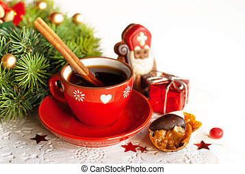 StNicholas day - Cup of hot tea with cinamon, with chocolat...