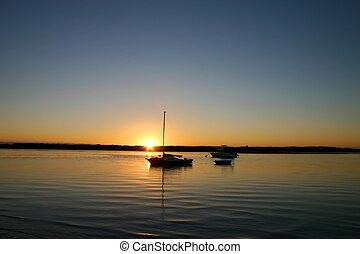 Boats At Dawn - Boats bathed in the still of morning sunrise...