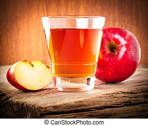 Apple juice. Fresh organic ripe apples and glass of juice on...