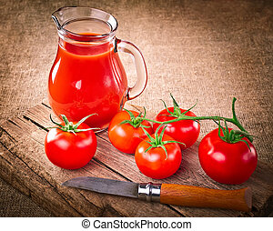 Tomato juice in glass jar, fresh organic tomatoes, steel...