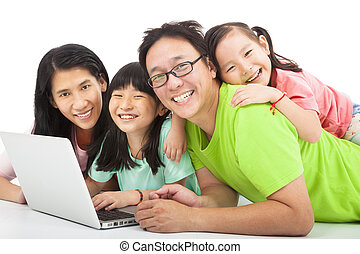 happy asian family with laptop